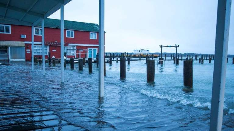 Minor flooding by Preston's dock in Greenport after