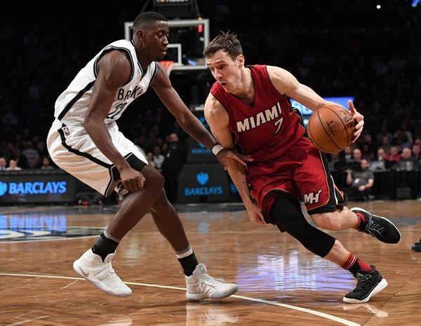 Heat guard Goran Dragic drives against Nets guard