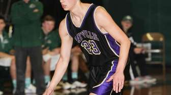 Sayville's Joey Harclerode (23) moves the ball in