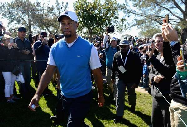 Tiger Woods walks to the seventh tee during