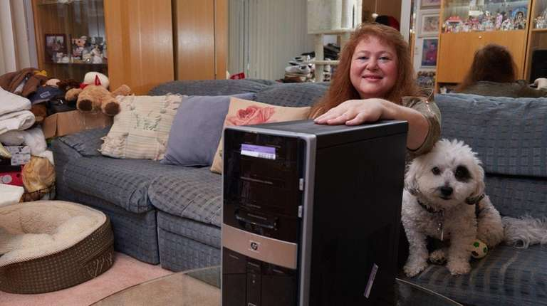 Alita Ditkowsky with her broken computer, which was