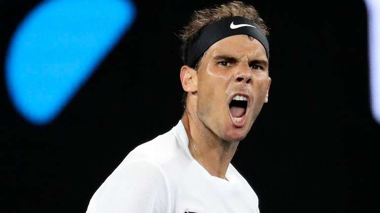 Spain's Rafael Nadal reacts after winning the third