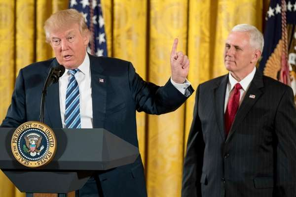 President Donald Trump, accompanied by Vice President Mike