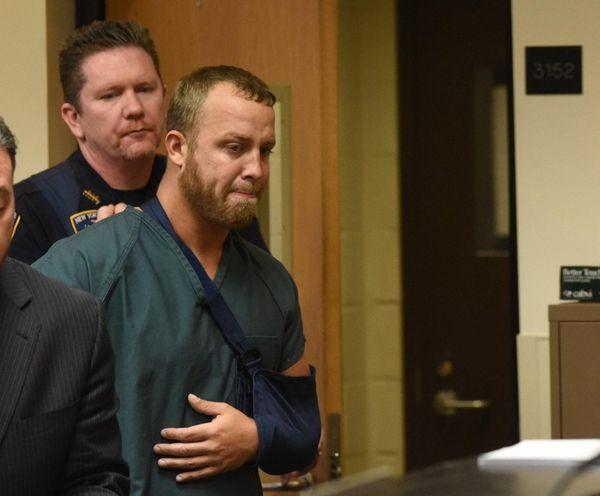 Michael Shear, 34, arrives for arraignment at Suffolk