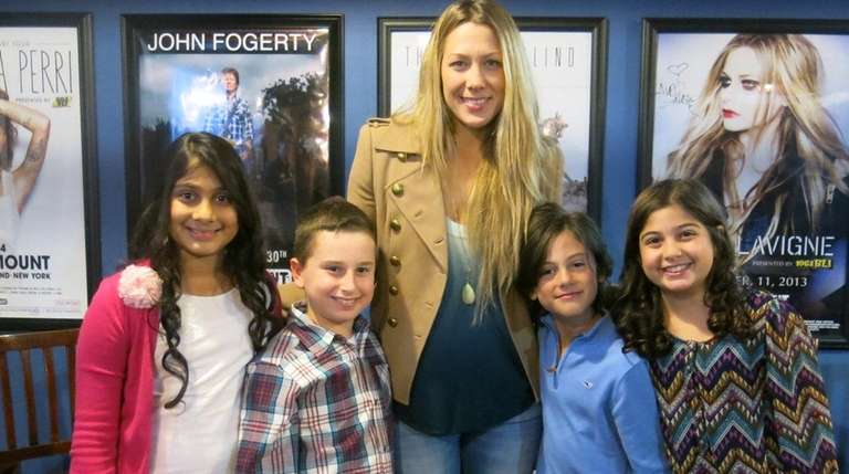 Singer Colbie Caillat meets with Kidsday reporters from