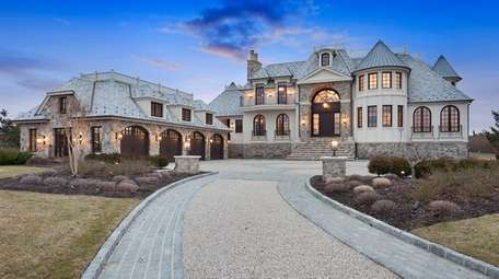 This five-bedroom Quogue home is on 1.72 acres