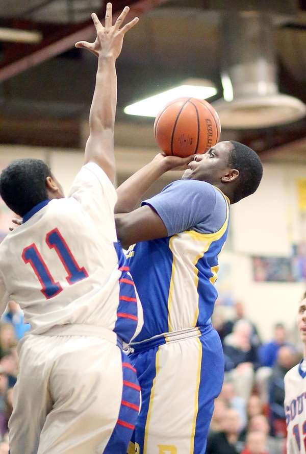 Roosevelt's Latrell Hollis goes for the basket during