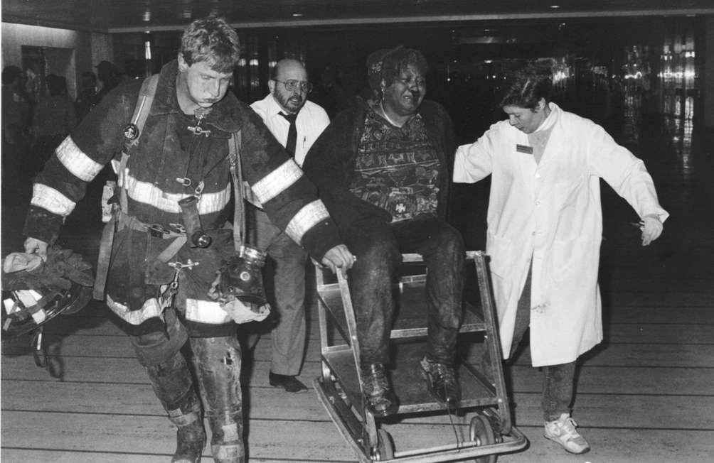 Rescue workers use a coffee cart to remove