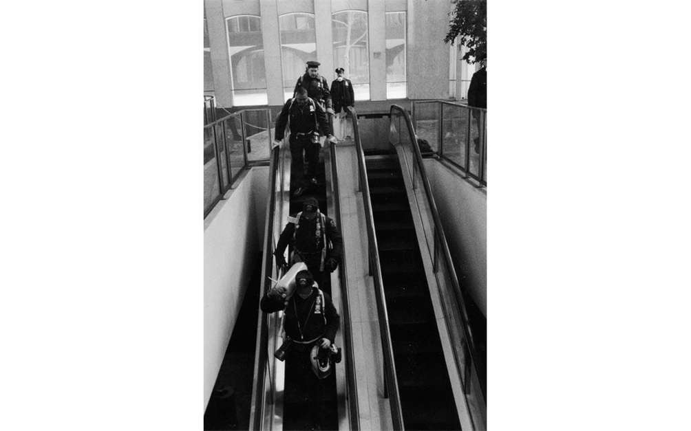 Firefighters head down an escalator at the World
