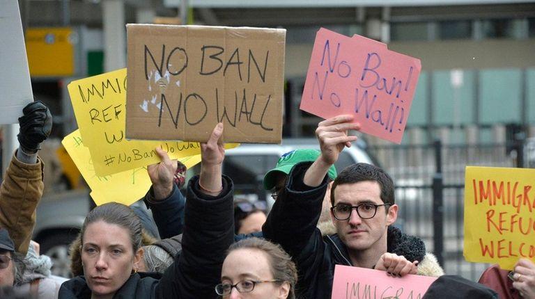 Demonstrators gathered outside Terminal 4 for international arrivals