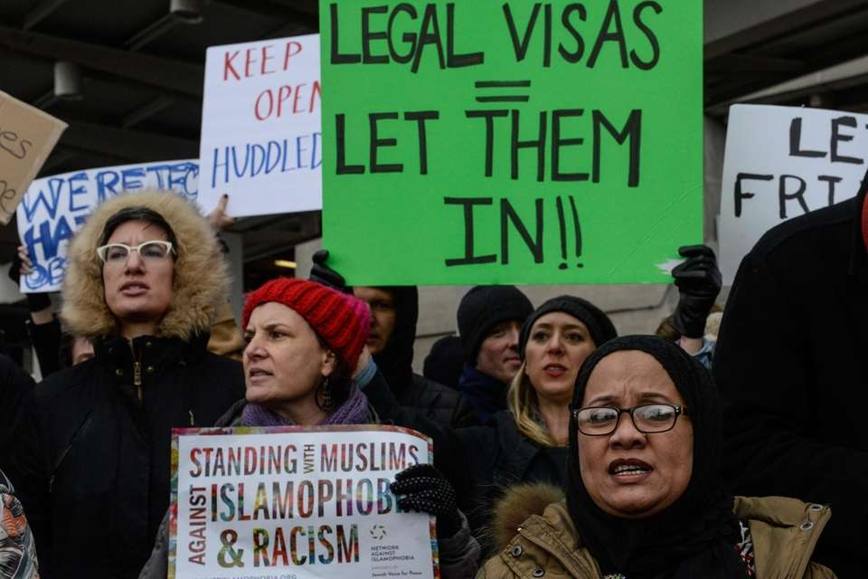 Protesters at Kennedy Airport call for travelers with