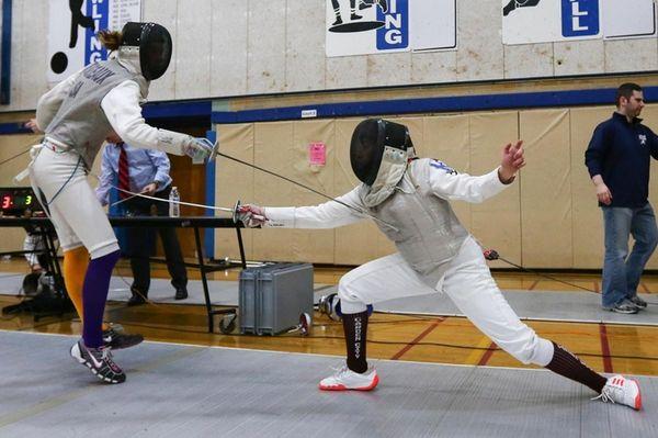 Tia Petrides against Kate Devereaux during fencing championships
