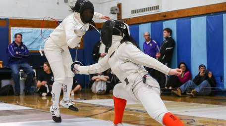 Anna Lin against Macy Meng during fencing championships