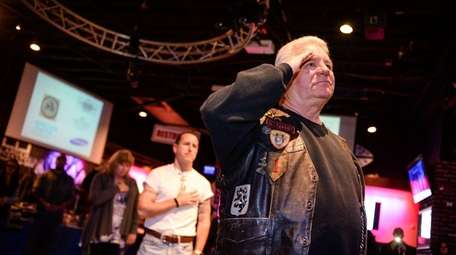 Bob Schiller, of Holtsville, salutes during the 12th