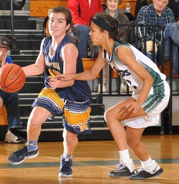 Helena Salmon of Massapequa, left, gets pressured by