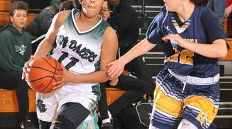 Aisha Smikle #11 of Farmingdale, left, looks to