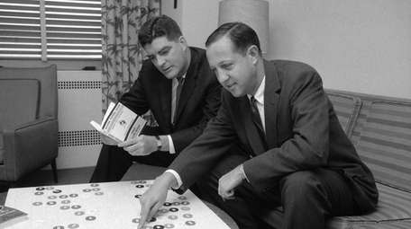 Pete Rozelle, right, National League Football Commissioner, moves