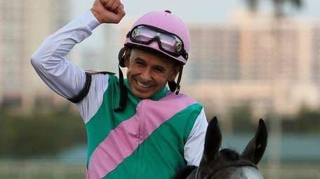 Jockey Mike Smith celebrates atop Arrogate after winning