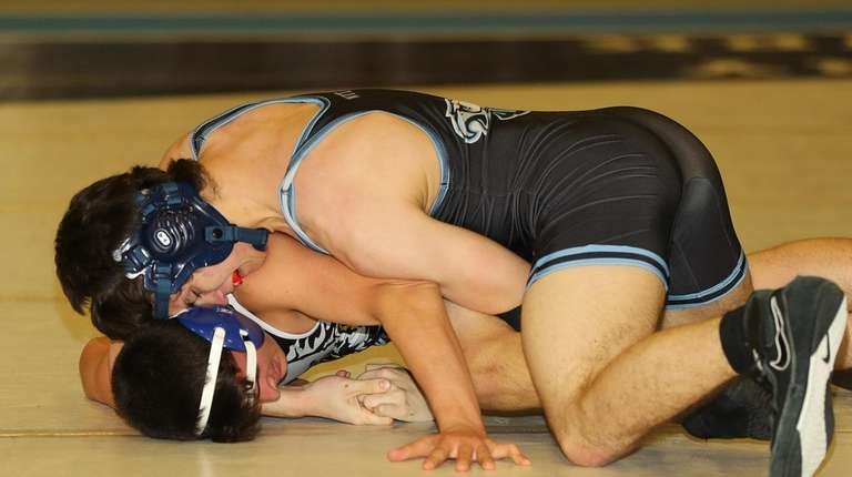 Rocky Point's Don Hammarth, top, controls Hauppauge's Anthony