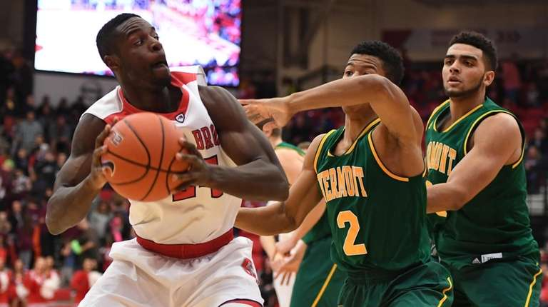 Stony Brook guard Roland Nyama looks for shooting
