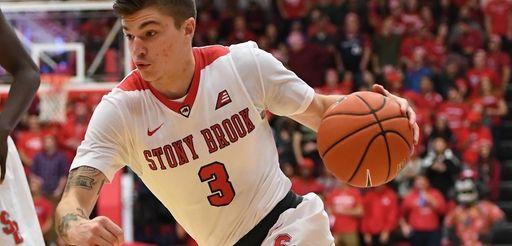 Stony Brook guard Kameron Mitchell drives the ball