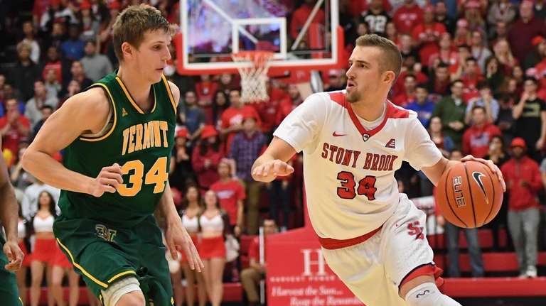Stony Brook guard Lucas Woodhouse brings the ball