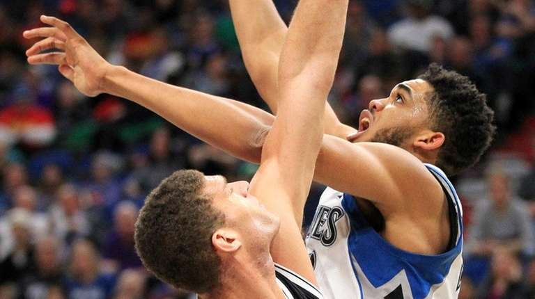 Minnesota Timberwolves center Karl-Anthony Towns shoots over Brooklyn