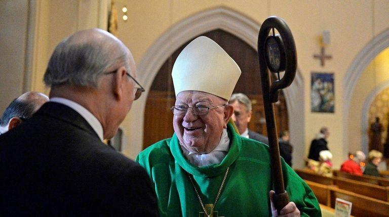 Bishop William Murphy meets with a parishioner at