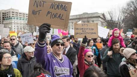WASHINGTON, DC - JANUARY 29: Demonstrators gather near