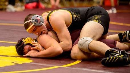 Maguire Horl (top) of St. Anthony's pins Frank