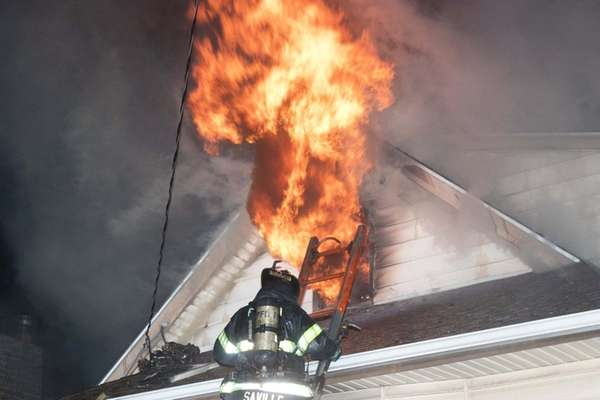 A firefighter battles a blaze early Monday, Jan.