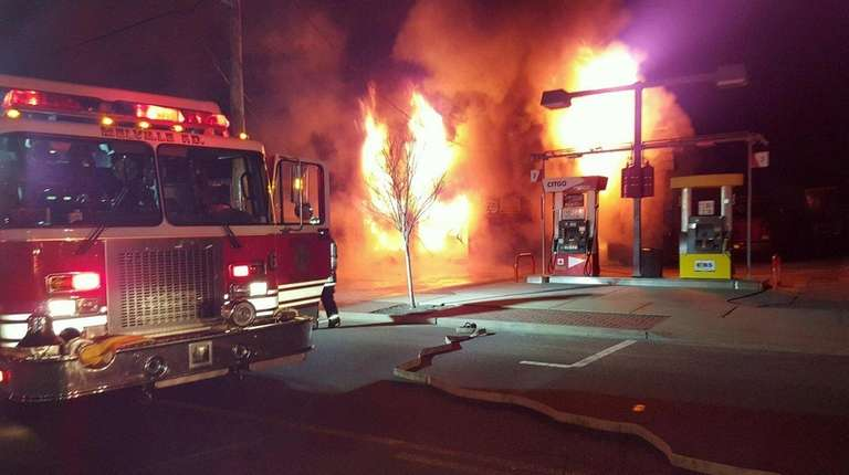 Firefighters battle a blaze at Richie's Citgo Station