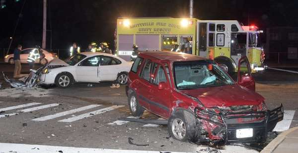 Firefighters and police respond to a two-vehicle crash