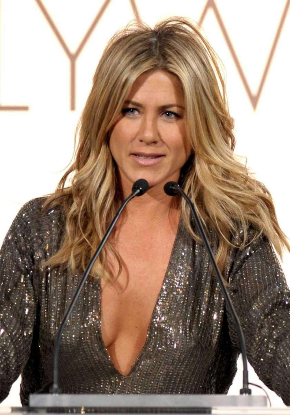 Honoree Jennifer Aniston speaks onstage during ELLE's 18th