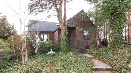 This Huntington Station Tudor is listed for $495,000