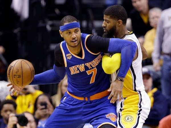 New York Knicks forward Carmelo Anthony works against