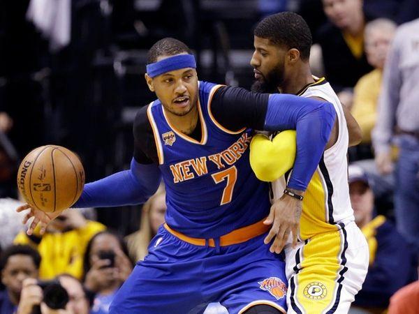 New York Knicks forward Carmelo Anthony works against