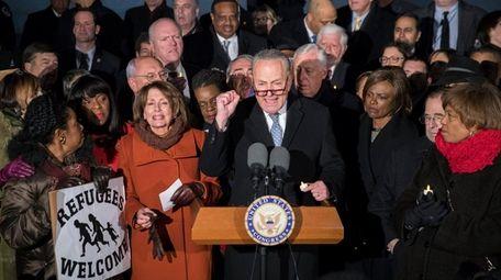 Senate Minority Leader Chuck Schumer, center, House Minority