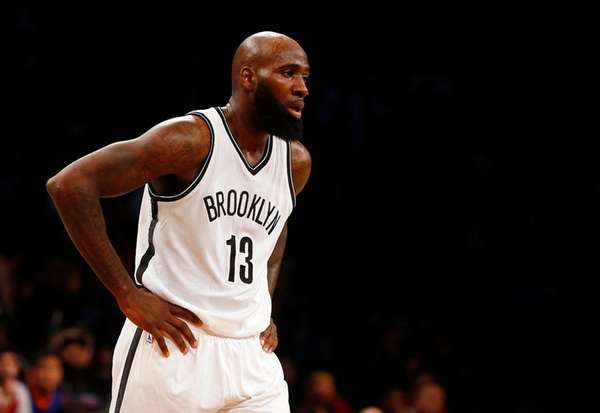 Quincy Acy of the Brooklyn Nets looks on