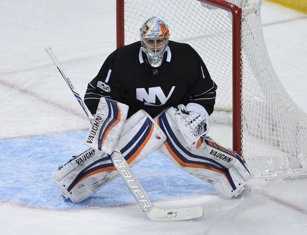 New York Islanders goalie Thomas Greiss protects the