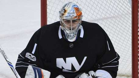 New York Islanders goalie Thomas Greiss protects the