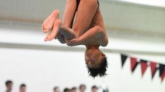 Cameron Yuen of Garden City dives during a