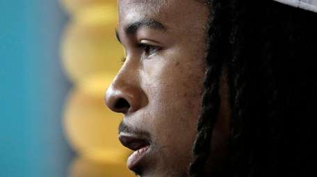 Atlanta Falcons' Devonta Freeman answers questions during opening