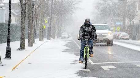 It was snowy going for bikes and vehicles