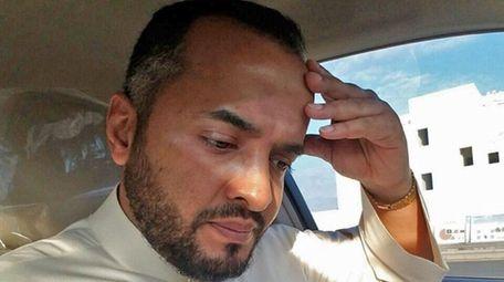 Abdulelah Othman, of Selden, in his car outside