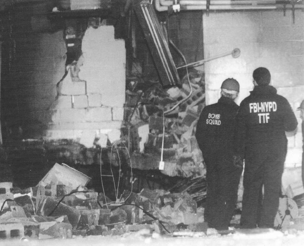 Members of the bomb squad and FBI examine