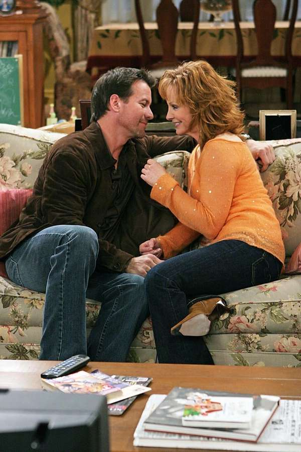 James Denton and Reba McEntire couch their comments