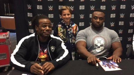 Kidsday reporter Justin Yakuel with WWE stars Xavier
