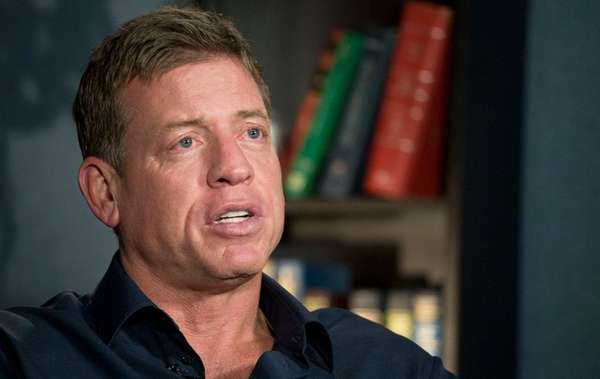 Former Dallas Cowboys quarterback Troy Aikman talks during