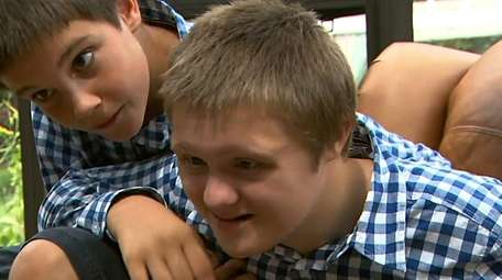Aiden Killoran, right, who has Down syndrome, is